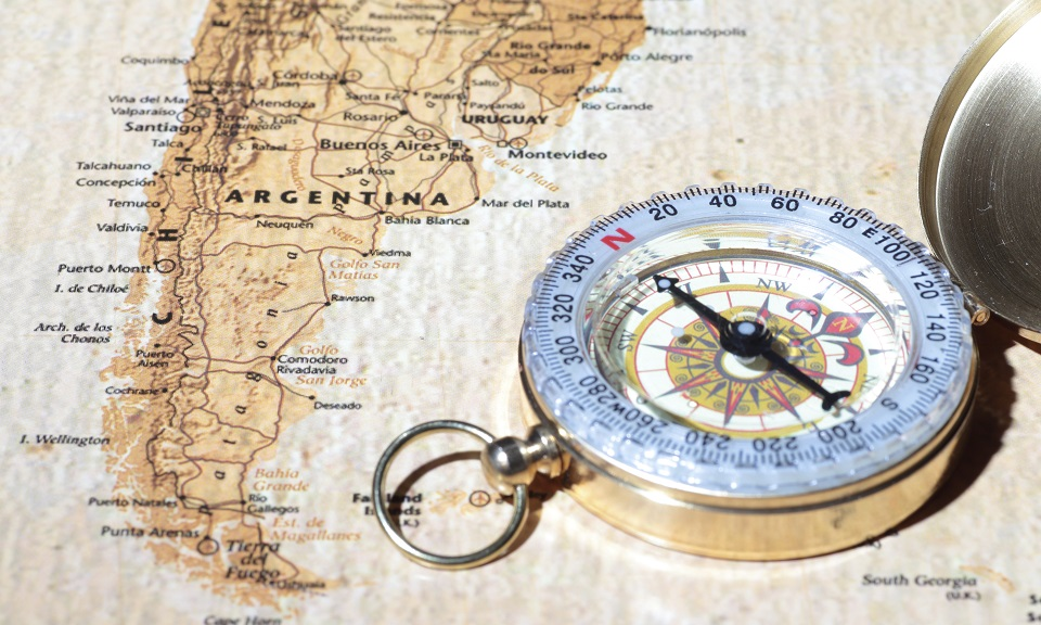 Travel destination Argentina, ancient map with vintage compass