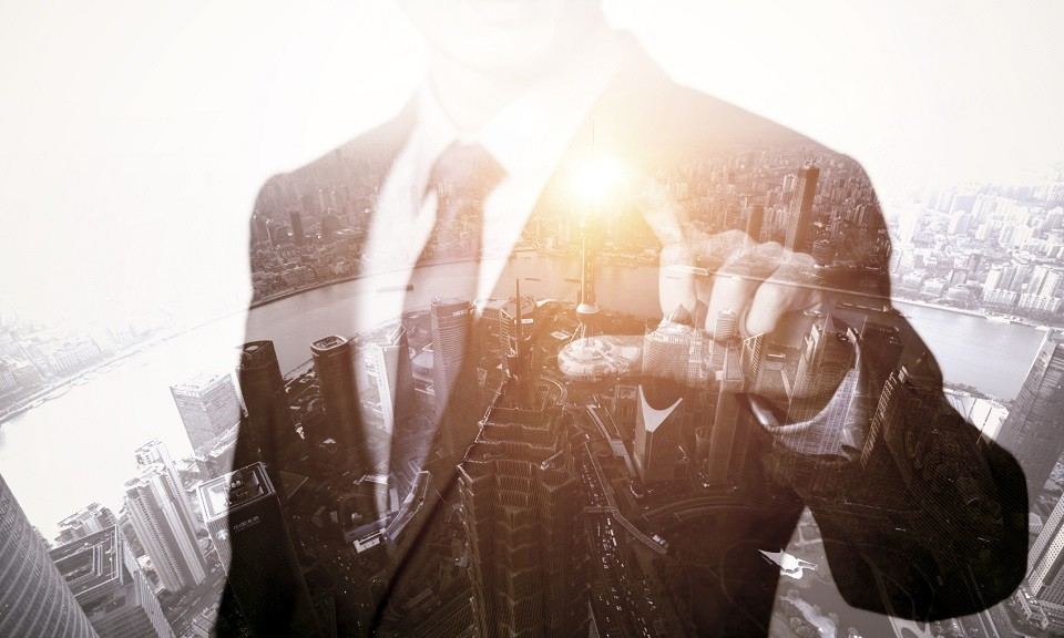 Shot of an unrecognizable businessman superimposed over a cityscape