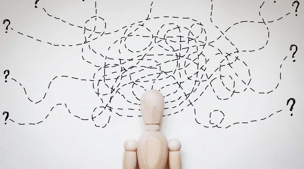 Man under stress because of too much problems. Abstract image with a wooden puppet