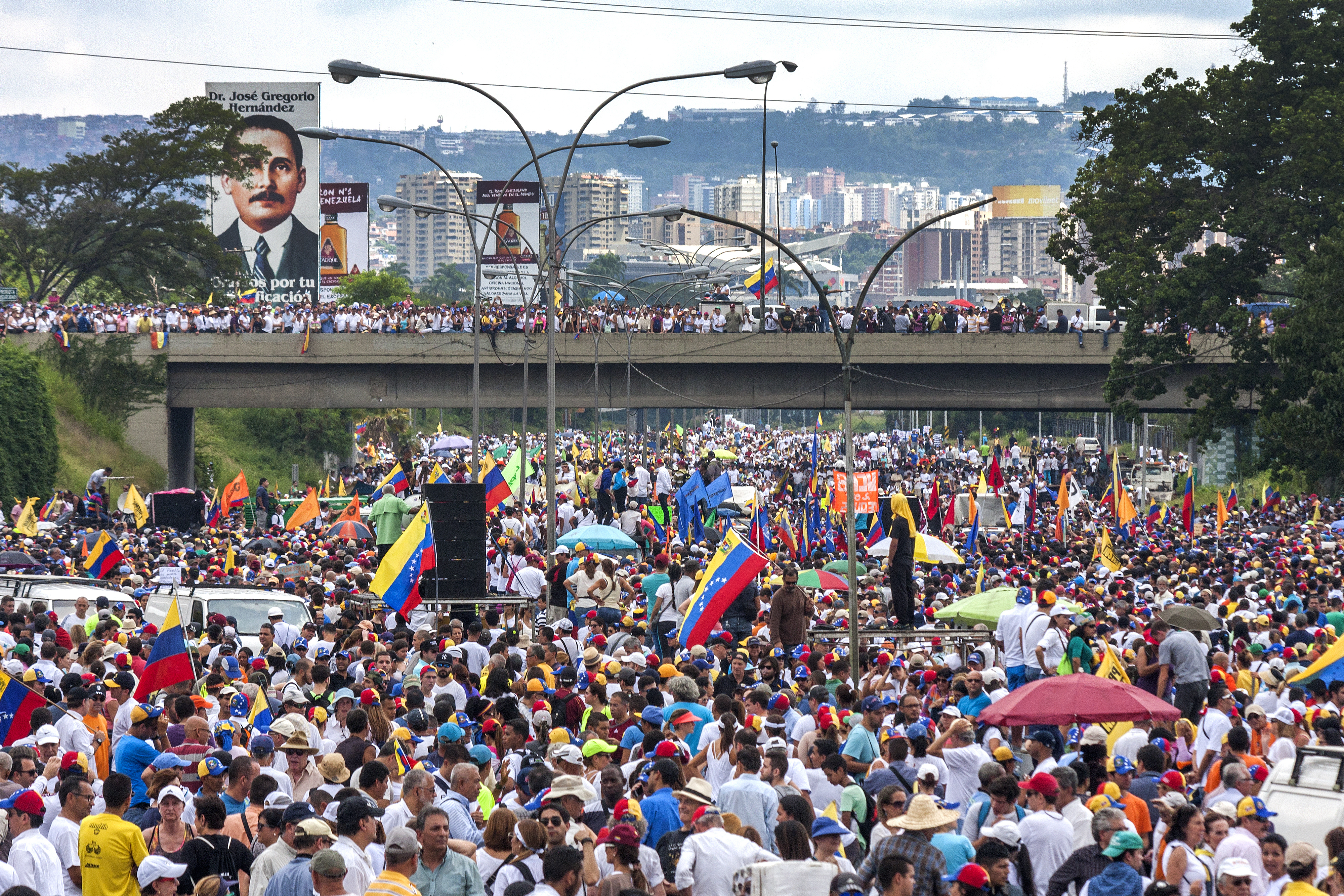 Demonstrators concentration against referendum cancellation. Caracas, Venezuela - October 26, 2016. Demonstrators concentrated protesting in Francisco Fajardo highway in Caracas against the cancellation of a constitutional referendum to revoke Venezuelan president in charge.