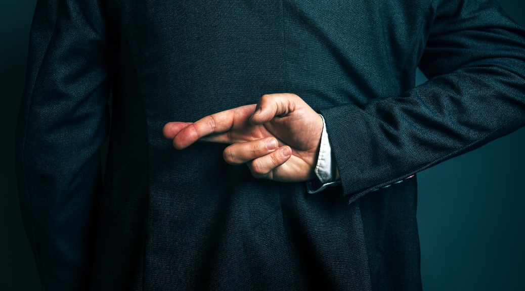 Dishonest businessman telling lies, lying businessperson holding fingers crossed behind his back